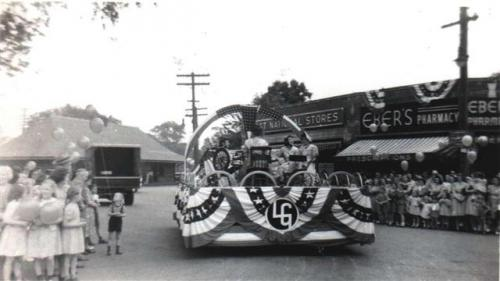 Parade Scene in front of Eber's Pharmacy